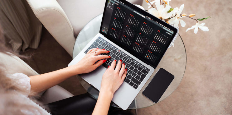 Young Woman Working/Typing on Her Laptop