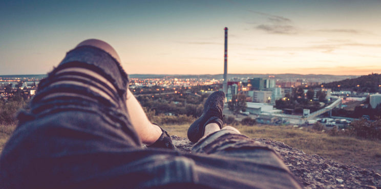Young Man Chilling and Enjoying Evening Cityscape View